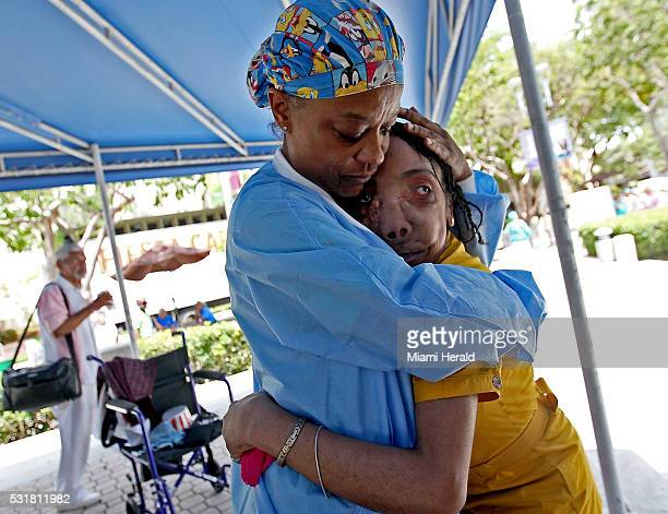 Jackson Health System employee Nancy Spain hugs Marlie Casseus a Haitian woman who had a 16pound tumor removed from her face 10 years ago at Jackson...