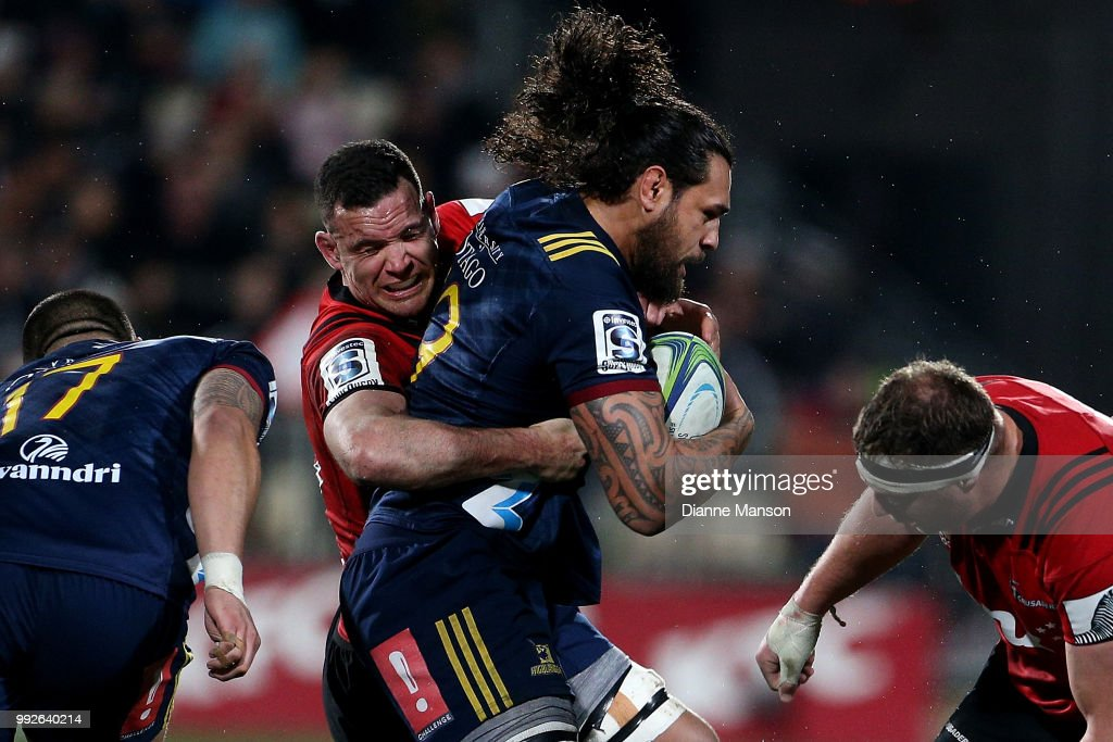 Jackson Hemopo of the Highlanders is tackled by Ryan Crotty of the Crusaders during the round 18 Super Rugby match between the Crusaders and the Highlanders at AMI Stadium on July 6, 2018 in Christchurch, New Zealand.