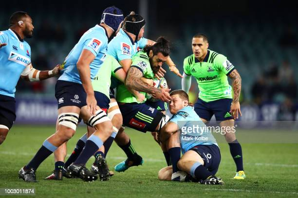 Alex Newsome Ned Hanigan and Nick Phipps of the Waratahs celebrate victory during the Super Rugby Qualifying match between the Waratahs and the...