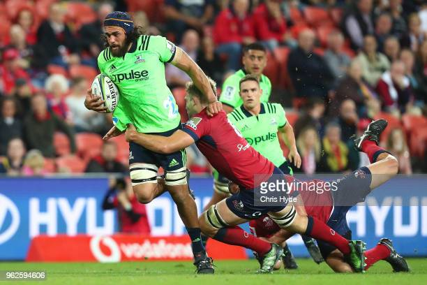 Jackson Hemopo the Highlanders makes a break during the round 15 Super Rugby match between the Reds and the Highlanders at Suncorp Stadium on May 26...