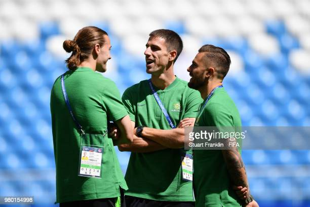 Jackson Irvine Milos Degenek and Joshua Risdon of Australia speak during a pitch inspection prior to the 2018 FIFA World Cup Russia group C match...