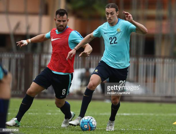 Jackson Irvine of Australia is chased by Bailey Wright during an Australia Socceroos training session at Hang Tuah Stadium on October 3 2017 in...