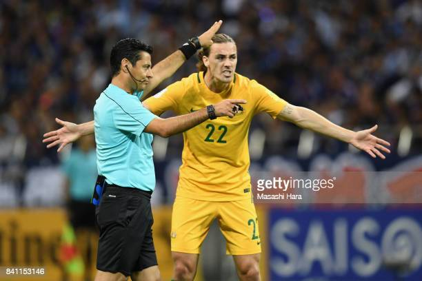 Jackson Irvine of Australia protests to referee Alireza Faghani during the FIFA World Cup Qualifier match between Japan and Australia at Saitama...