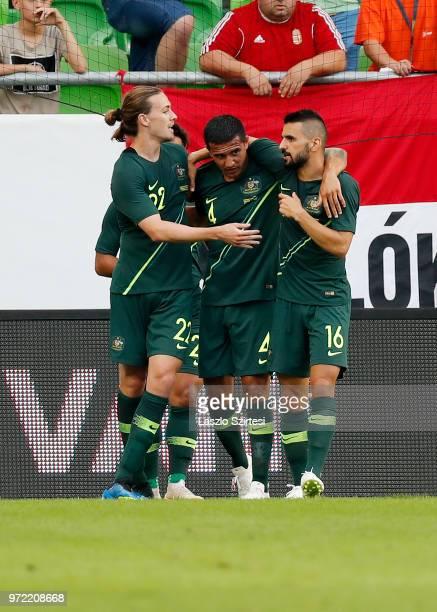 Jackson Irvine of Australia Tim Cahill of Australia and Aziz Behich of Australia celebrate the winning goal during the International Friendly match...