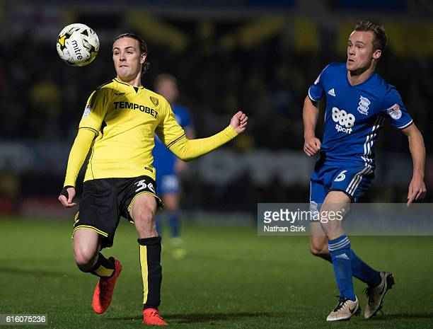 Jackson Irvine of Burton Albion and Jonathan Grounds of Birmingham in action during the Sky Bet Championship match between Burton Albion and...