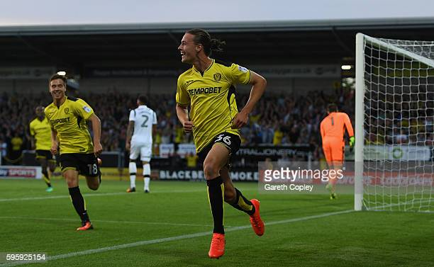 Jackson Irvine of Burton celebrates scoring the opening goal during the Sky Bet Championship match between Burton Albion and Derby County at Pirelli...