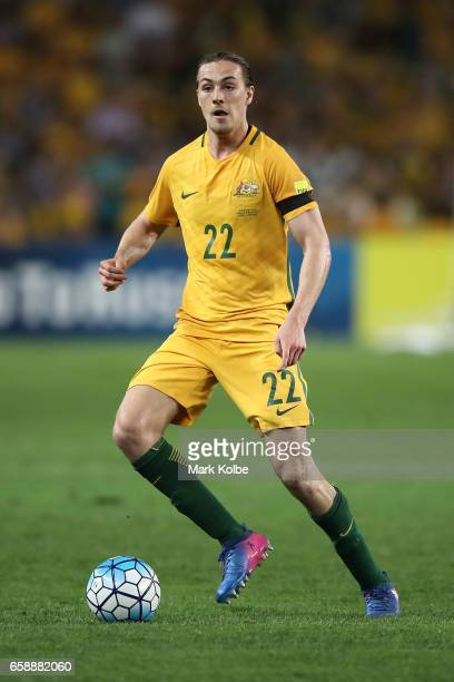 Jackson Irvine of the Socceroos runs the ball forward during the 2018 FIFA World Cup Qualifier match between the Australian Socceroos and United Arab...