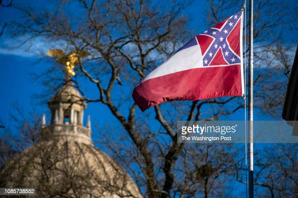 The Mississippi State Capitol dome is visible in the distance as the flag of the state of Mississippi flies nearby in Jackson MS on January 10 2019
