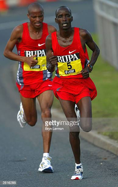 Jackson Koech of Kenya leads Henrik Ramaala of South Africa during the Mens' Half Marathon during the BUPA Great North Run on September 21 2003 in...
