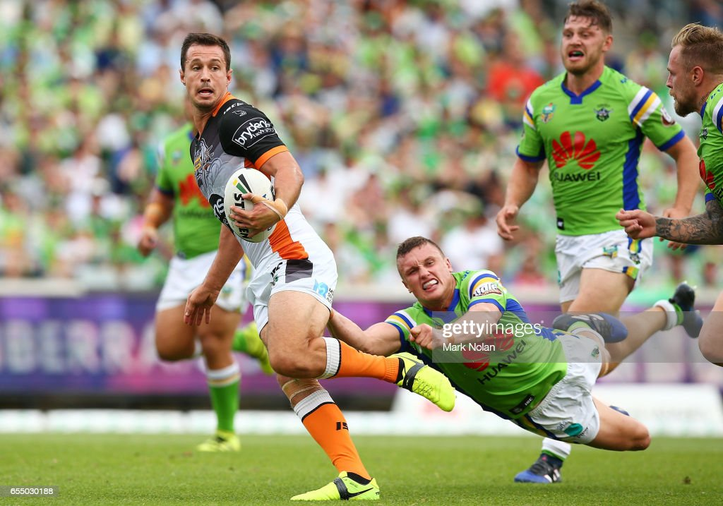 Jackson Littlejohn of the Tigers makes a line break during the round three NRL match between the Canberra Raiders and the Wests Tigers at GIO Stadium on March 19, 2017 in Canberra, Australia.