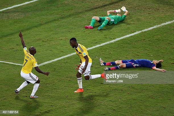 Jackson Martinez celebrates scoring his team's second goal with Pablo Armero of Colombia during the 2014 FIFA World Cup Brazil Group C match between...