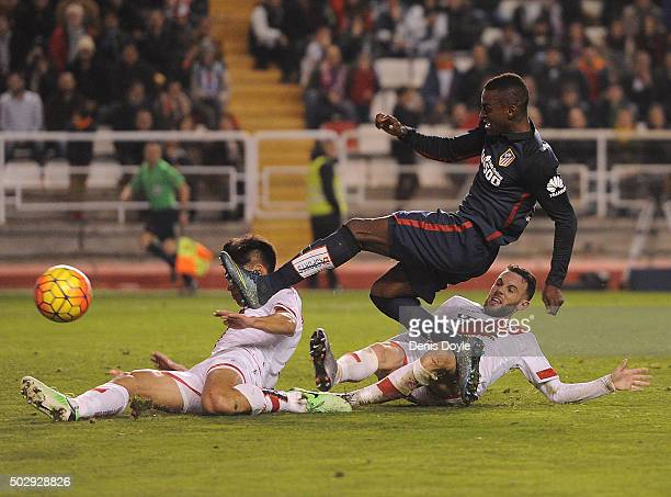 Jackson Martinez of Club Atletico de Madrid gets his shot blocked by Zhang Chengdong of Rayo Vallecano during the La Liga match between Club Atletico...