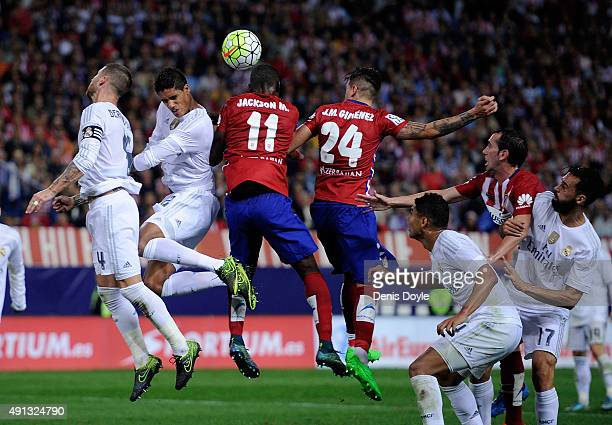 Jackson Martinez of Club Atletico de Madrid goes for a high ball against Rafael Varane of Real Madrid during the La Liga match between Club Atletico...