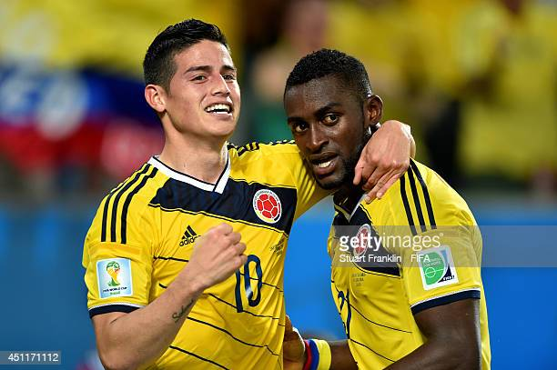 Jackson Martinez of Colombia celebrates scoring his team's third goal with his teammate James Rodriguez during the 2014 FIFA World Cup Brazil Group C...