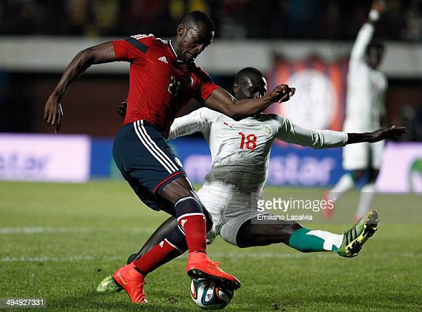 Jackson Martinez of Colombia fights for the ball with Christophe Diedhiou of Senegal during the International Friendly match between Colombia and...