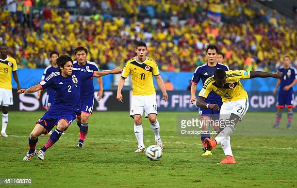 Jackson Martinez of Colombia shoots and scores his team's second goal during the 2014 FIFA World Cup Brazil Group C match between Japan and Colombia...