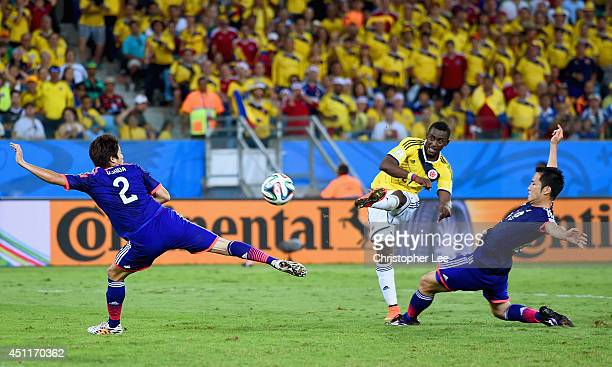 Jackson Martinez of Colombia shoots and scores his team's third goal during the 2014 FIFA World Cup Brazil Group C match between Japan and Colombia...