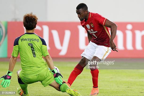 Jackson Martinez of Guangzhou Evergrande attempts a goal against Shin Hwa Yong of Pohang Steelers during the Asian Champions League match between...