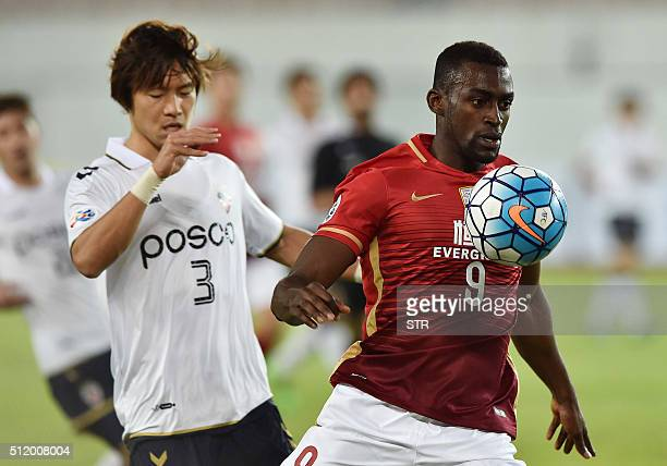 Jackson Martinez of Guangzhou Evergrande fights for the ball with Kim Kwangsuk of Pohang Steelers during their AFC Champions League group stage...