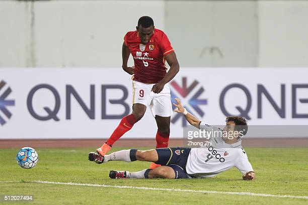 Jackson Martinez of Guangzhou Evergrande in action against Park Junhui of Pohang Steelers during the AFC Champions League match between Guangzhou...