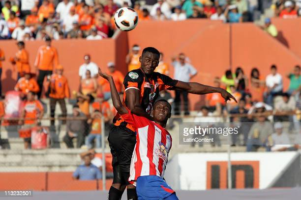 Jackson Martinez of Jaguares struggles for the ball with Jossimar Andres Gomez of Junior of Barranquilla during a match as part of the Santander...