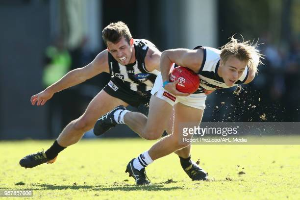 Jackson Mclachlan of Geelong Cats is tackled during the round six VFL match between the Collingwood Magpies and the Geelong Cats at Olympic Park on...