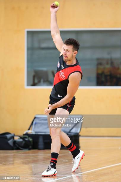Jackson Merrett of the Bombers bowls before an Essendon Bombers team photo session at The Hangar on February 6 2018 in Melbourne Australia