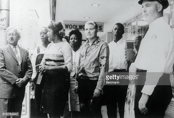 Four of a group of five biracial sit ins are shown outside the Woolworth store in downtown Jackson soon after the store was closed when violence...