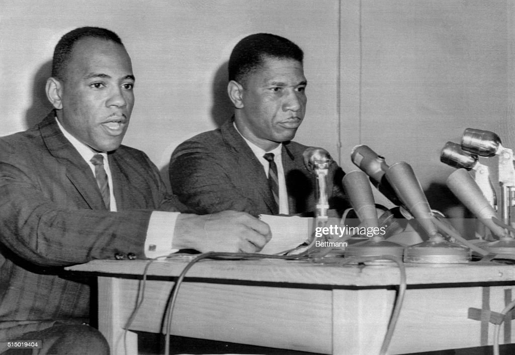 To Return To Ole Miss. James H. Meredith (left) reads prepared statement at news conference January 30, saying he has decided to return to the University of Mississippi for the spring semester. Meredith, 29, who was greeted by rioting last fall when he became the first Negro to enter the University, said he sees signs that give him hope he will 'be able to go to school in the future under adequate if not ideal, conditions.' At right is Medgar Evers, Mississippi NAACP President.