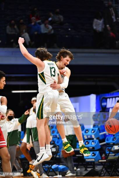 Jackson Moffatt and Matthew Mayer of the Baylor Bears celebrate their win over the Wisconsin Badgers in the second round of the 2021 NCAA Division I...