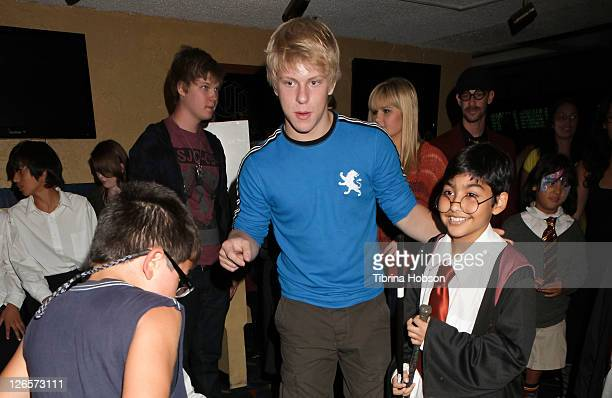Jackson Odell and guest attend the Starlight Children's Foundation's celebrity bowling event on September 25 2011 in Cerritos California