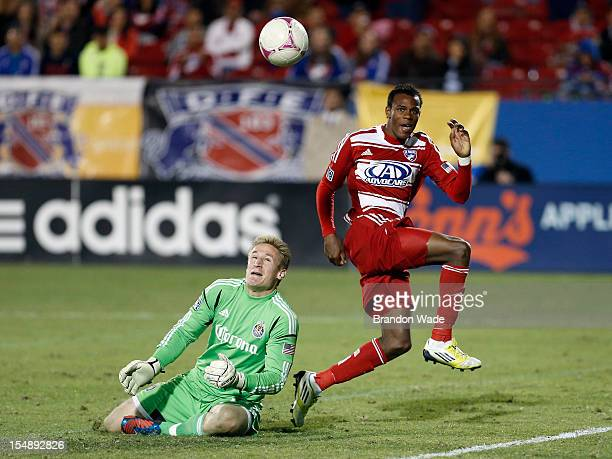 Jackson of FC Dallas attempts to lob the ball over goalkeeper Tim Melia of Chivas USA during the second half of a soccer game at Pizza Hut Park on...