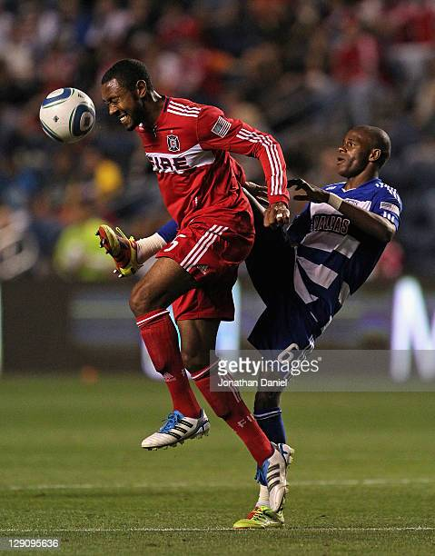 Jackson of FC Dallas kicks the ball away from Cory Gibbs of the Chicago Fire during an MLS match at Toyota Park on October 12, 2011 in Bridgeview,...