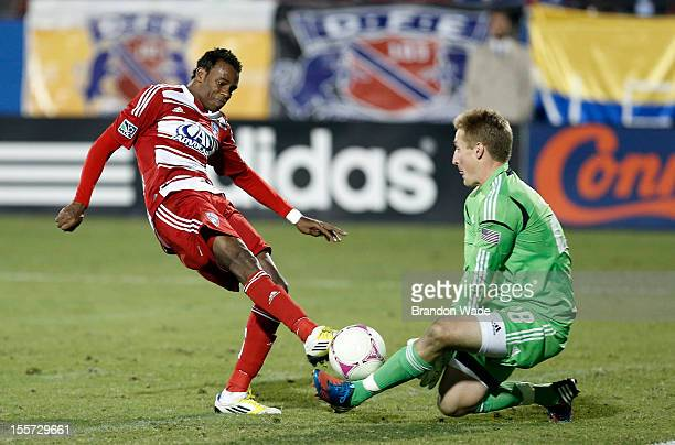 Jackson of FC Dallas shoots the ball over goalkeeper Tim Melia of Chivas USA during the second half of a soccer game at Pizza Hut Park on October 28...