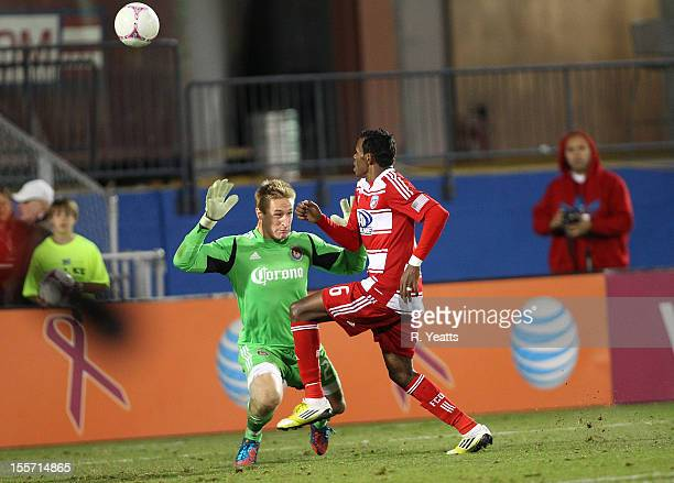 Jackson of FC Dallas shoots the ball over Tim Melia of Chivas USA to score a goal at FC Dallas Stadium on October 28 2012 in Frisco Texas