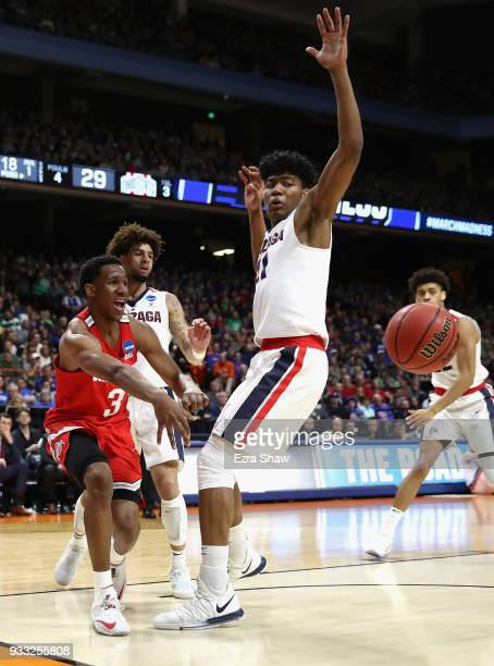 J Jackson of the Ohio State Buckeyes passes the ball during the first half against Rui Hachimura of the Gonzaga Bulldogs in the second round of the...
