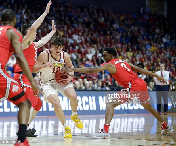 J Jackson of the Ohio State Buckeyes reaches and tries to steal the ball from Michael Jacobson of the Iowa State Cyclones in the first round of the...
