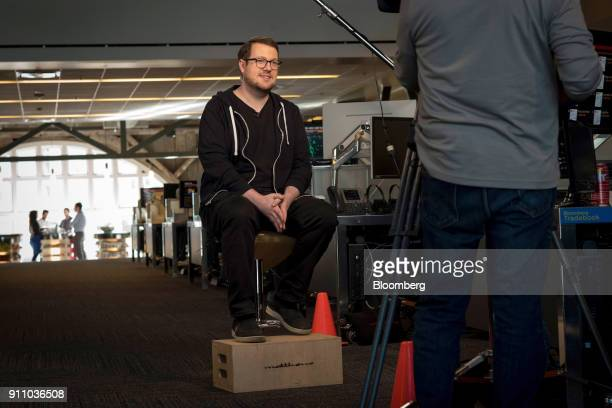 Jackson Palmer cofounder of Dogecoin listens during a Bloomberg Technology television interview in San Francisco California US on Monday Jan 22 2018...