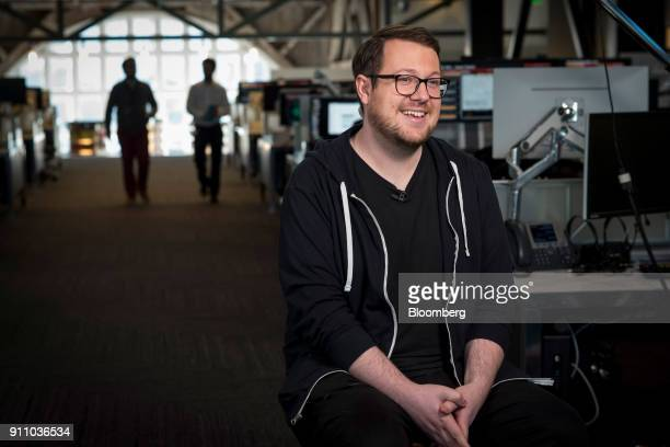 Jackson Palmer cofounder of Dogecoin smiles during a Bloomberg Technology television interview in San Francisco California US on Monday Jan 22 2018...