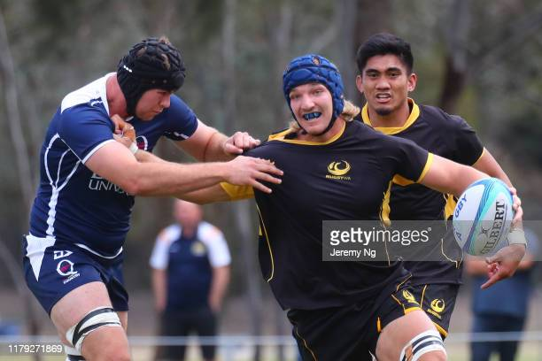Jackson Pugh of Western Australia fends during the round 2 National U19s Championship match between Queensland Country URC and Rugby Western...