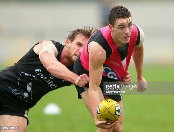 Jackson Ramsay of the Magpies is tackled by Lachlan Keeffe during a Collingwood Magpies AFL training session at Olympic Park on June 3 2014 in...