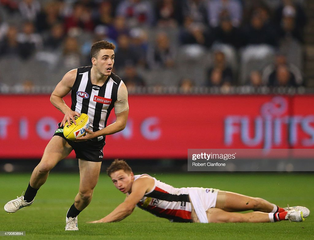 Jackson Ramsay of the Magpies runs with the ball during the round three AFL match between the Collingwood Magpies and the St Kilda Saints at the Melbourne Cricket Ground on April 17, 2015 in Melbourne, Australia.