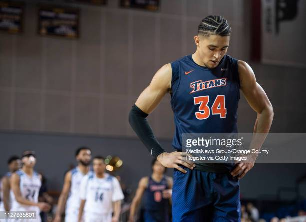 Jackson Rowe of the Cal State Fullerton Titans waits for UC Irvine free throw during the closing seconds of their men's basketball game at Bren...