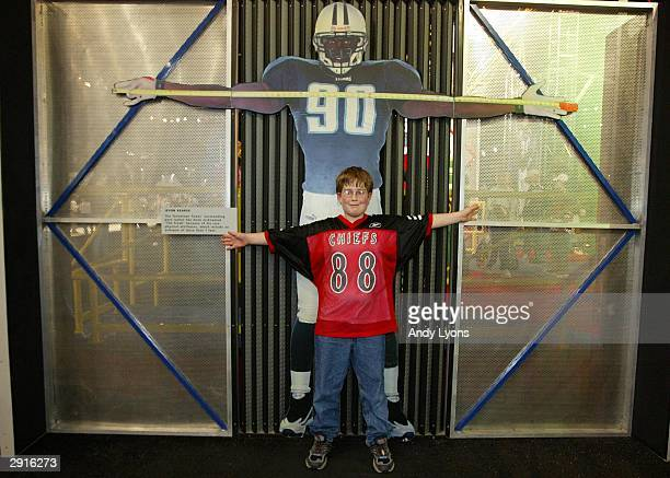 Jackson Senter of Friendwood Texas checks his arm span at the NFL Experince on January 30 2004 at the George R Brown Convention Center in Houston...