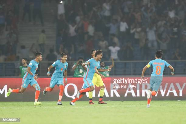 Jackson Singh Thounaojam of India celebrates with his teammates after scoring his his team's first goal to make it 11 during the FIFA U17 World Cup...