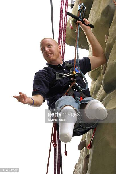 BJ Jackson spokesman for the Coalition to Salute America's Heroes and an Iraq war veteran climbs a man made rock wall set up at Disney World in...