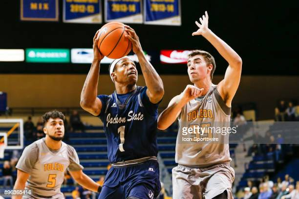 Jackson State Tigers guard Charles Taylor Jr goes in for a layup against Toledo Rockets forward Nate Navigato during a regular season nonconference...