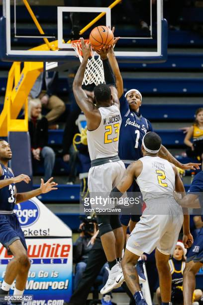 Jackson State Tigers guard Charles Taylor Jr tries to block a shot by Toledo Rockets forward Willie Jackson during a regular season nonconference...