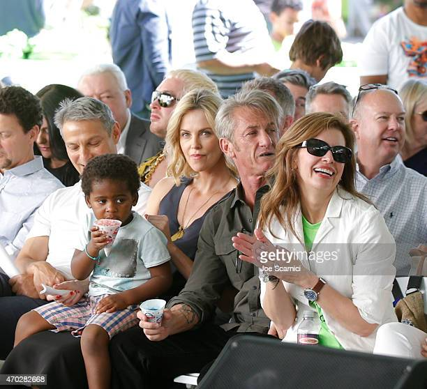 Jackson Theron actress Charlize Theron actor Sean Penn and CEO of Points of Light Tracy Hoover attend the Points of Light generationOn Block Party on...