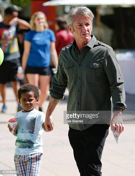Jackson Theron and actor Sean Penn attend the Points of Light generationOn Block Party on April 18 2015 in Los Angeles California